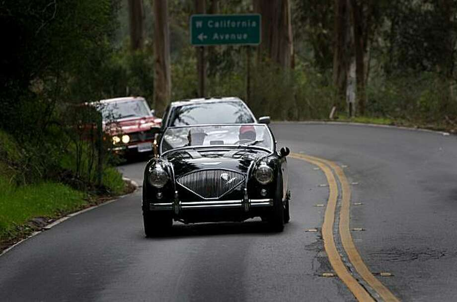 Classic cars drive on Highway 1 towards Stinson Beach during the annual Anti-Football car rally near Sausalito, Calif., on Friday, Jan. 1, 2010. Dozens of exotic cars participated in the 113-mile drive through the back roads of Marin County to offer an alternative to watching New Years Day bowl games. Photo: Paul Chinn, The Chronicle