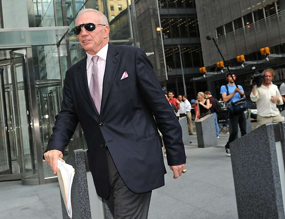 Dallas Cowboys owner Jerry Jones exits a law firm where contract talks ended, Friday, July 15, 2011, in New York. Significant progress on a major sticking point in the NFL labor impasse, soaring rookie salaries, during marathon talks Thursday raised hopesthat a tentative agreement in principle could perhaps come within 24 hours, according to two people familiar with the negotiations. Photo: Louis Lanzano, AP