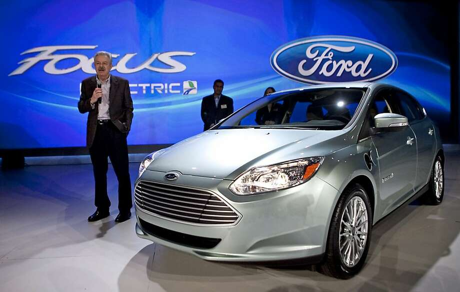 Derrick Kuzak, head of product development for Ford Motor Co., left, unveils the Ford Focus Electric during a media preview at the 2011 International Consumer Electronics Show (CES) in Las Vegas, Nevada, U.S., on Thursday, Jan. 6, 2011. Ford will unveil a battery-powered version of its Focus small car on Jan. 7 in an attempt to grab some of the publicity rivals General Motors Co. and Nissan Motor Co. are getting from their electric models. Photographer: Andrew Harrer/Bloomberg *** Local Caption *** Derrick Kuzak Photo: Andrew Harrer, Bloomberg