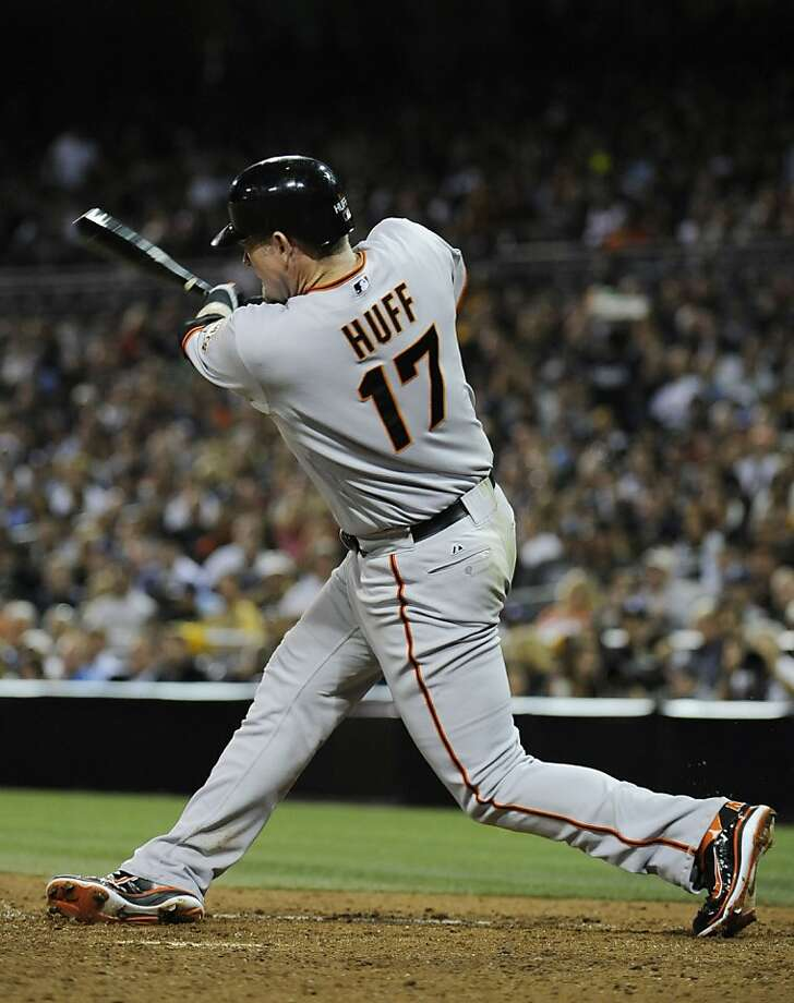 SAN DIEGO, CA - JULY 14: Aubrey Huff #17 of the San Francisco Giants hits a solo home run during the ninth inning of a baseball game against the San Diego Padres at Petco Park on July 14, 2011 in San Diego, California. Photo: Denis Poroy, Getty Images