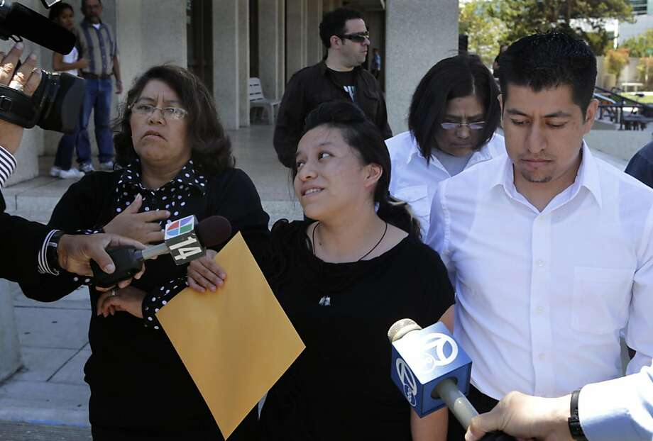 Ivonne Garcia-Lopez, center, leaves the San Mateo County Superior Court after attending the arraignment for Fabian Zaragoza in Redwood City, Calif. on Wednesday, July 13, 2011. Zaragoza, 17, is accused in the shooting death of Garcia-Lopez's three-month-old son Izack, who was shot while in the backseat of his family's car. Photo: Paul Chinn, The Chronicle