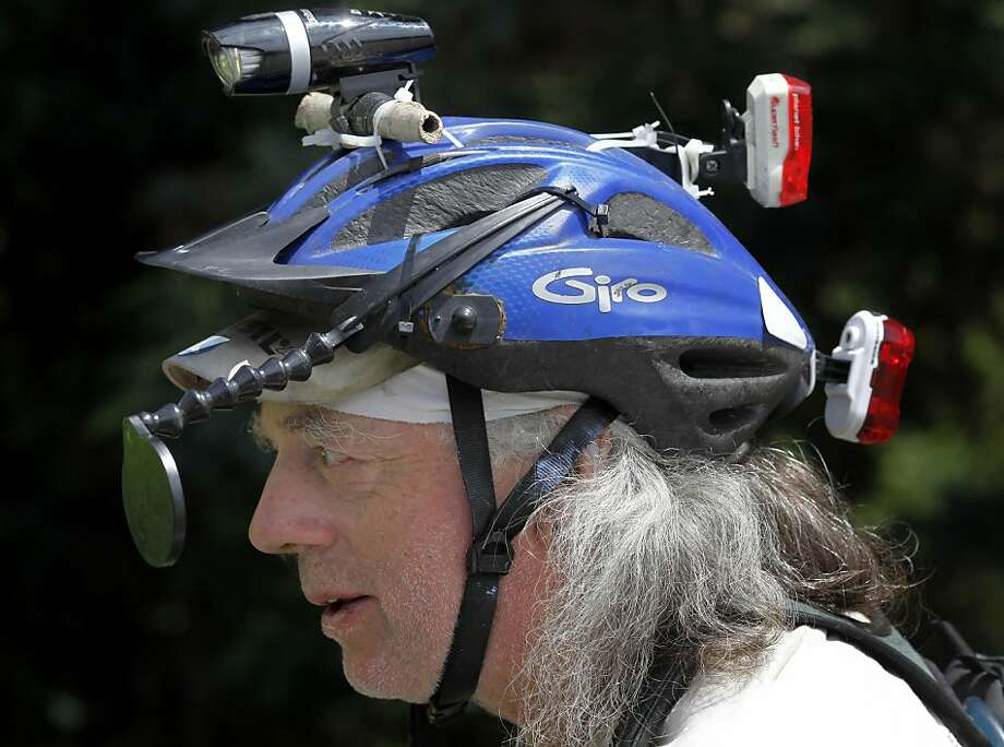 Brian Willson has various lights, and mirrors around his helmet to make the journey across two states safer. Brian Willson lost his legs beneath a train in 1987 as he was trying to block munitions into the Concord Naval Weapons Station.  Now he is riding from his home in Oregon to the Bay Area by hand-cycle to promote his new book and the peace movement he loves. Photo: Brant Ward, The Chronicle