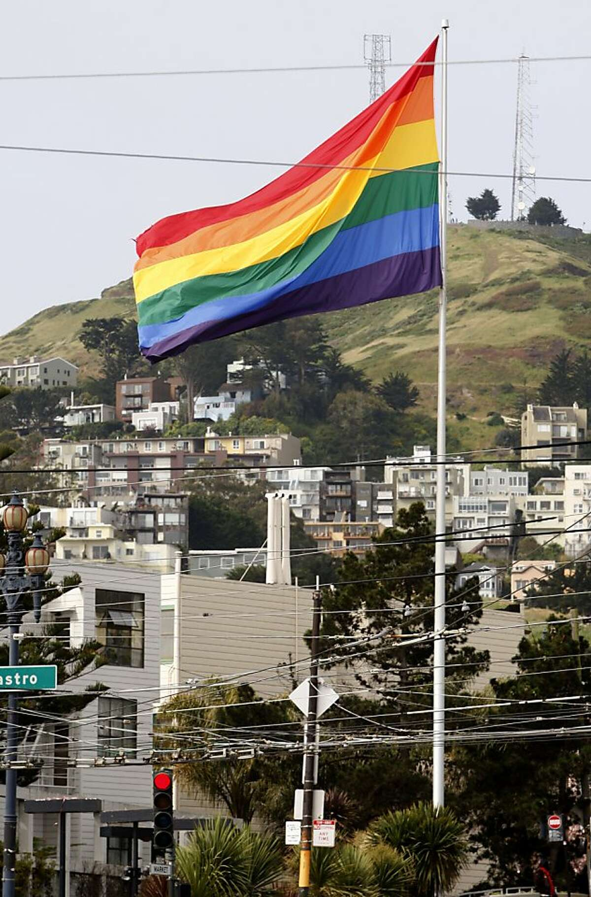 The gay pride rainbow flag flies at Market and Castro streets in San Francisco, Calif. on Saturday, April 23, 2011. Activist Michael Petrelis is urging community leaders to fly the stars and stripes on Harvey Milk Day but is meeting resistance to his idea.
