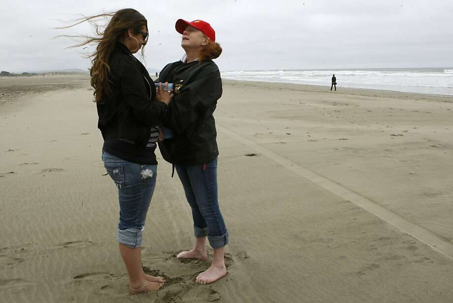 Mother Claudia Stevens (right) is joined by Erica Menezes (left), college friend of Danielle Keller, as Claudia hugs the urn of her daughter's ashes before bringing some to the waterline at Ocean Beach in San Francisco, Calif. on Monday, July11, 2011.  She is honoring the anniversary and memory of her daughter, Danielle Keller,who was murdered with a baseball bat two years ago.  Erica and Danielle were best friends before her death and had flown in from southern California for the anniversary and verdict. Photo: Liz Hafalia, The Chronicle