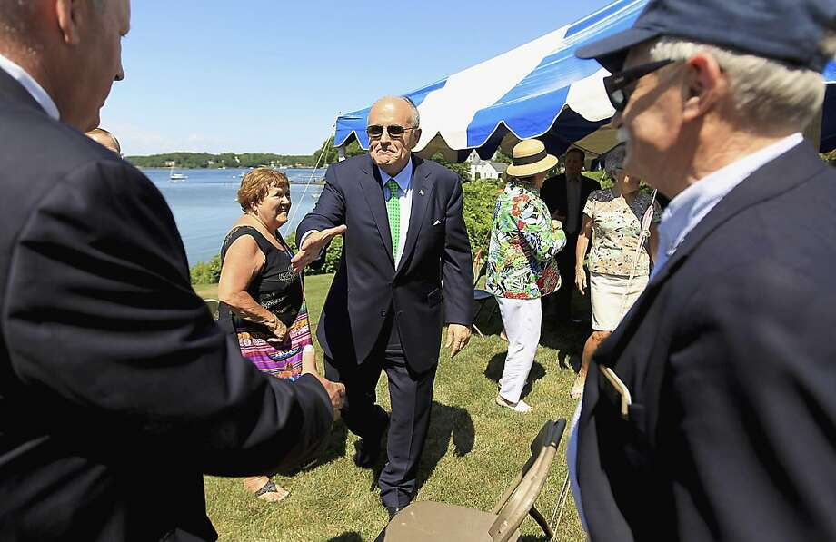 Former New York City Mayor Rudy Giuliani reaches to shakes hands at a house party in New Castle, N.H., Thursday, July 14, 2011. Photo: Cheryl Senter, AP