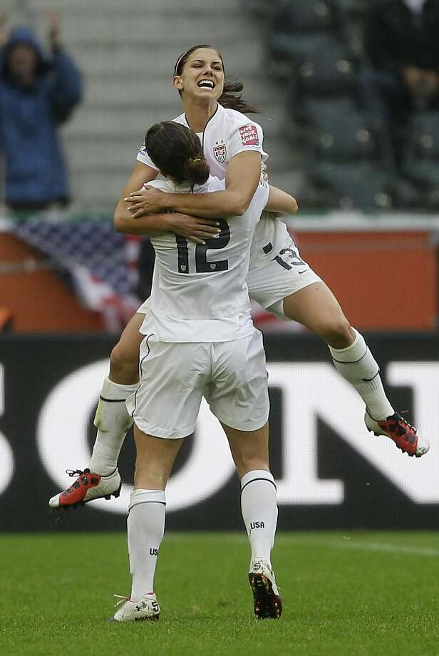 United States' Alex Morgan is carried by United States' Lauren Cheney after scoring their side's 3rd goal during the semifinal match between France and the United States at the WomenÍs Soccer World Cup in Moenchengladbach, Germany, Wednesday, July 13, 2011. Photo: Frank Augstein, AP