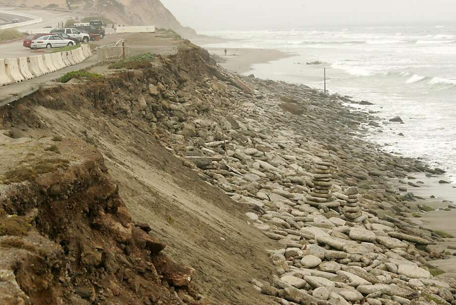 Increased erosion during the winter of 2010 has caused road closures and the city to seek more reinforcement in the area. San Francisco could get permission to install more rocks and two new walls of pilings at Ocean Beach under a permit the California Coastal Commission will consider Wednesday. Photo: Mathew Sumner, Special To The Chronicle