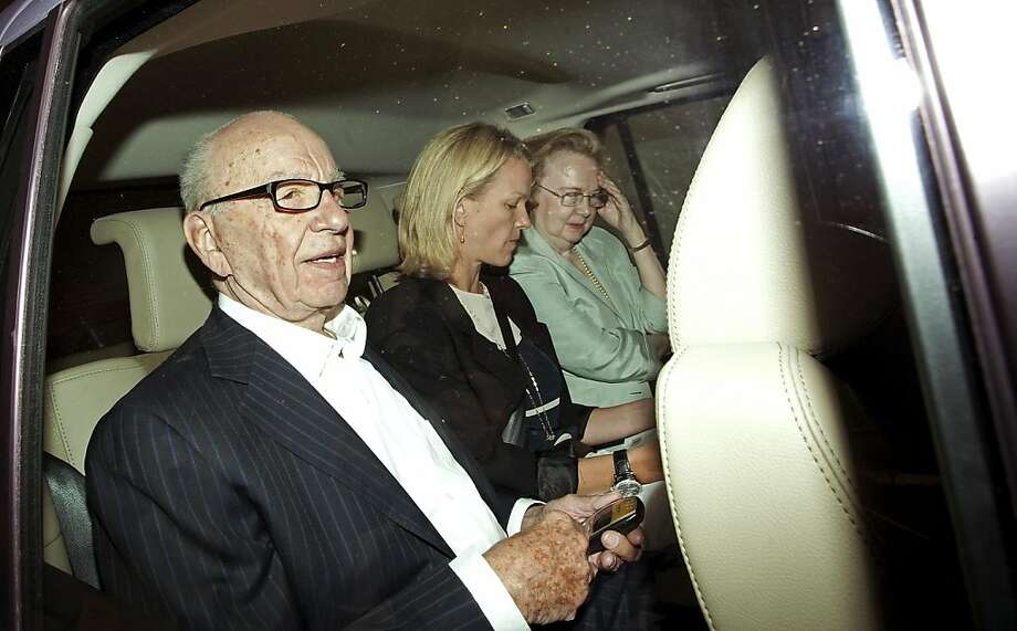 Rupert Murdoch, chief executive officer of News Corp., left, and his daughter Elisabeth Murdoch, centre, are driven from his apartment in London, U.K., on Tuesday, July 12, 2011. News Corp. bought itself time to weather the furor over phone hacking at the now-defunct News of the World by pushing U.K. Culture Secretary Jeremy Hunt to refer its bid for British Sky Broadcasting Group Plc to regulators. Photographer: Simon Dawson/Bloomberg *** Local Caption *** Rupert Murdoch; Elisabeth Murdoch Photo: Simon Dawson, Bloomberg