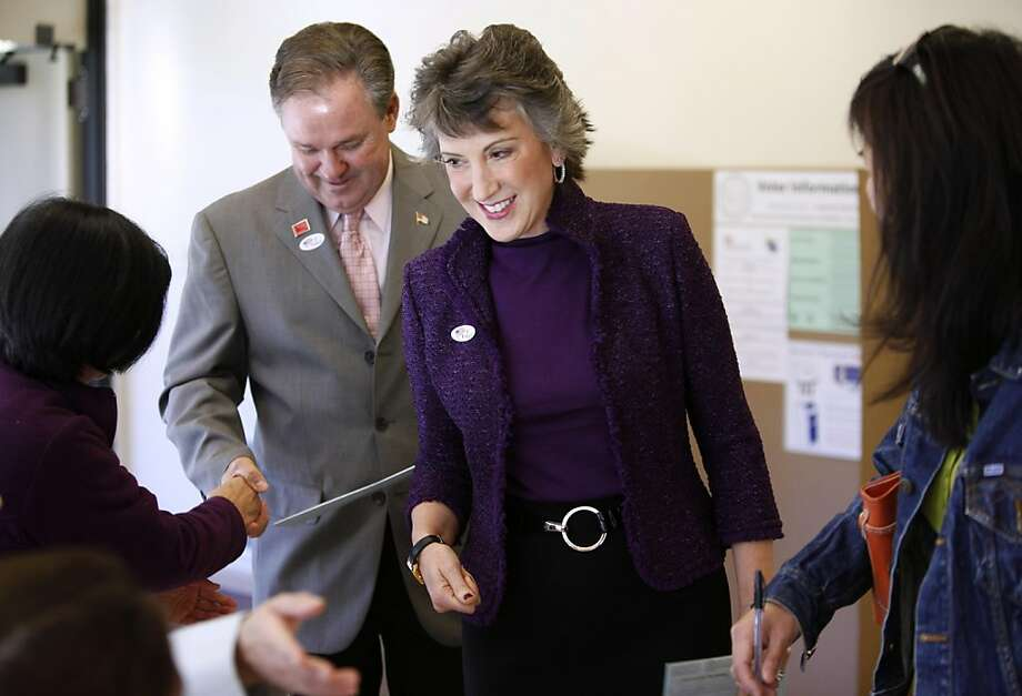 California Senate candidate Carly Fiorina casts her ballot with her husband Frank Fiorina, at a polling place in Los Altos Hills, Calif., Tuesday, Nov. 2, 2010. Fiorina, the former CEO of Hewlett-Packard, is running against incumbent Sen. Barbara Boxer, (D-Calif.) Photo: Paul Sakuma, AP