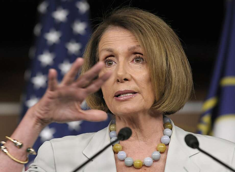 House Minority Leader Nancy Pelosi of Calif. gestures during a news conference on Capitol Hill in Washington, Tuesday, July 12, 2011, a debt ceiling negotiations continued. Photo: Susan Walsh, AP