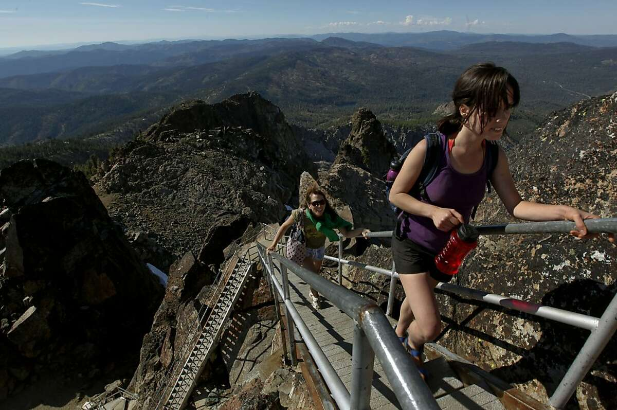 LIz Schoelen, of San Francsico, (right) and Pam Raymond, of Pacifica, make their way up the 176 steps to the Forest service tower, now an observation platform, for a spectacular view from the Sierra Buttes on Thursday June 25, 2009, in the Tahoe National Forest, Calif.