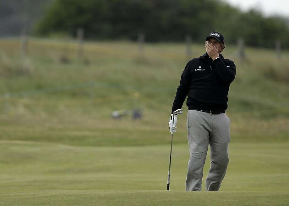 Phil Mickelson of the US reacts after playing a shot on the 17th fairway during a practice round ahead of the British Open Golf Championship at Royal St George's golf course in Sandwich, England, Wednesday, July 13, 2011. Photo: Matt Dunham, AP