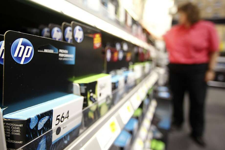 A Hewlett-Packard Co. printer ink cartridge is displayed for sale while a customer browses at a Best Buy Co. Inc. store in Orem, Utah, U.S., on Monday, May 16, 2011. Hewlett-Packard Co., the world's biggest personal-computer maker, cut a billion dollars from its sales forecast for the year and said profit is falling short as consumers hold back buying PCs. Photographer: George Frey/Bloomberg Photo: George Frey, Bloomberg