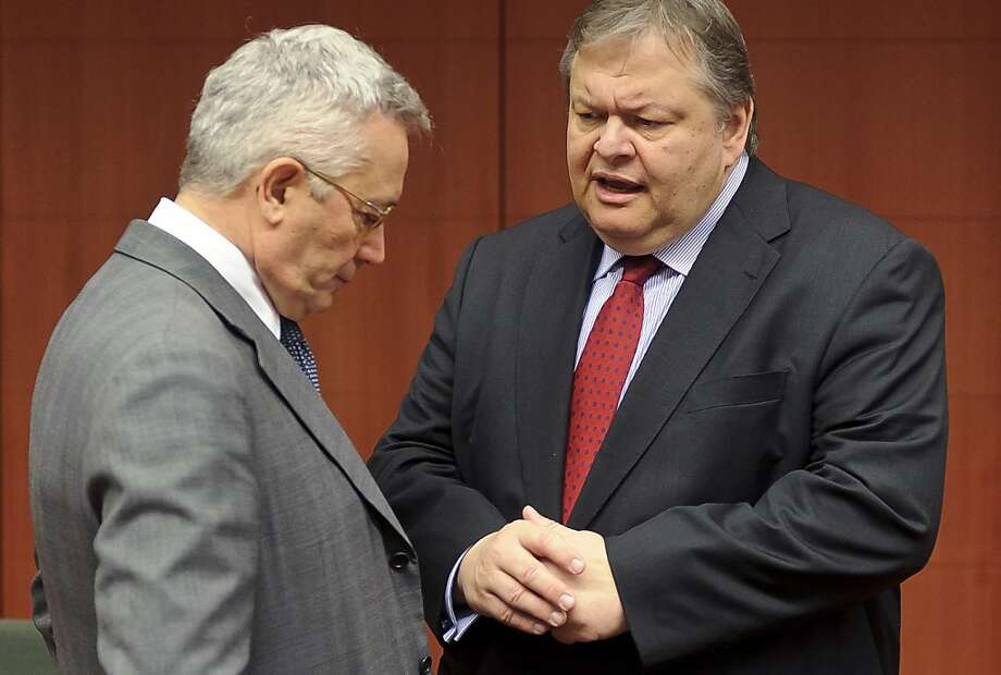 Giulio Tremonti, Italy's finance minister, left, reacts as he speaks with Evangelos Venizelos, Greece's finance minister, during a meeting of European Union finance ministers at the European Council headquarters in Brussels, Belgium, on Monday, July 11, 2011. European finance chiefs clashed over how to dig Greece out of its financial hole just as markets battered the bonds of Spain and Italy, opening a new front in the debt crisis. Photographer: Jock Fistick/Bloomberg *** Evangelos Venizelos; Giulio Tremonti Photo: Jock Fistick, Bloomberg