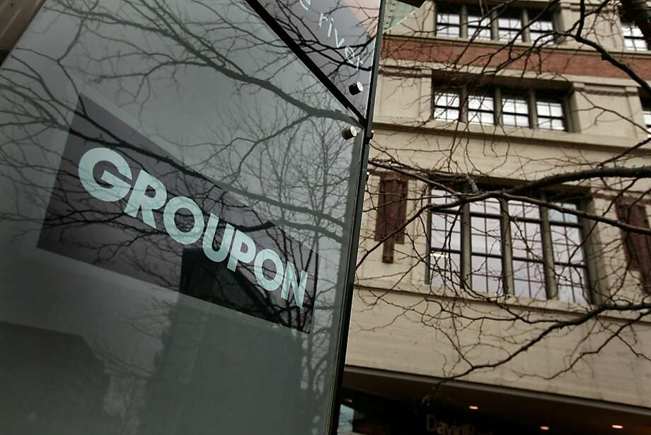"(FILES) This November 30, 2010 file photo shows a sign marking the location of the Groupon headquarters in Chicago, Illinois. On June 29, 2011 the Indian subsidiary of online deals giant Groupon has accidentally published email addresses and passwords from its subscriber database, the company and reports said.  Groupon said in a statement sent to AFP that it ""was alerted to a security issue"" affecting its Sosasta.com subsidiary on June 24 and that it ""corrected the problem immediately."" Photo: Scott Olson, AFP/Getty Images"