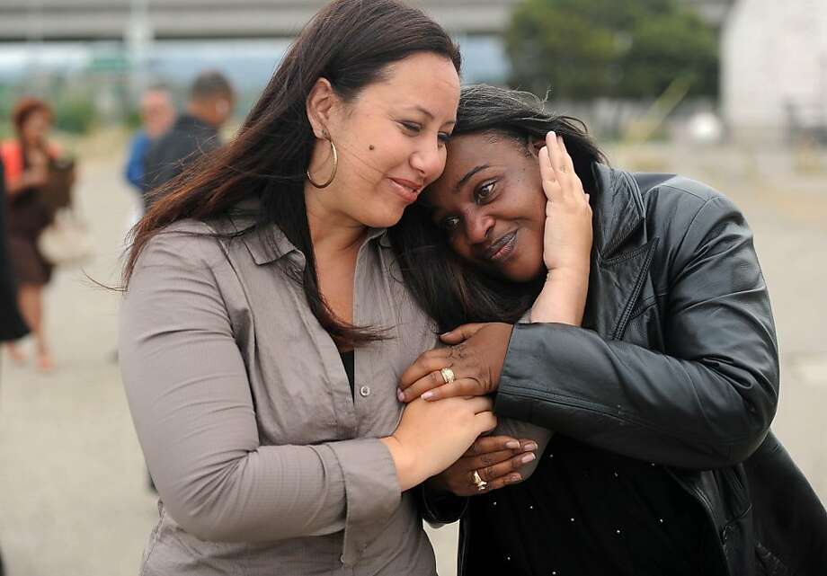 Adreienn Huffman of Caltrans (left) gives Leceda Evans, mother of fallen Caltransê employee Dêjuan Bush, a hug after a press conference in Oakland on July 11, 2011.  In light of the recent Caltrans' worker fatalities, Caltrans in partnership with the Office of Traffic Safety (OTS), the California Highway Patrol (CHP), and the Department of Motor Vehicle (DMV), will launch the 'Move Over It's The Law' campaign to highlight to motorist the importance of slowing down and moving over a lane, when safe, when the motorists see flashing lights. Photo: Susana Bates, Special To The Chronicle