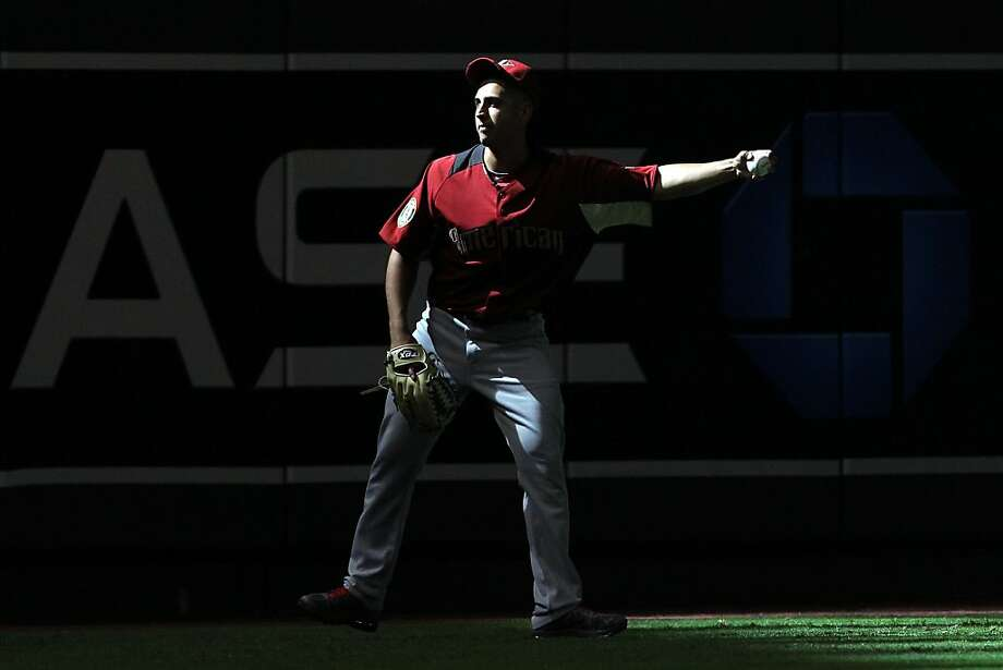 PHOENIX, AZ - JULY 11:  American League All-Star Gio Gonzalez of the Oakland Athletics throws the ball during the Gatorade All-Star Workout Day at Chase Field on July 11, 2011 in Phoenix, Arizona. Photo: Christian Petersen, Getty Images