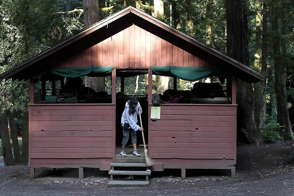 Beautiful Emily, From The Older Group Of Girls, Sweeps Out The Cabin Before It Is