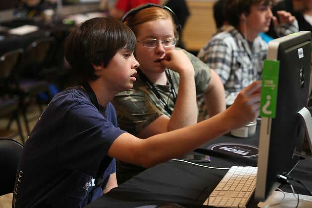 Campers Megan Walley, 17 (left) checks out the app Kevin Krause (left) , 14, of Saratoga works on developing during the iPhone and iPad App Development course of the iD Programming Academy on Wednesday, July 6, 2011 in Stanford, Calif. Photo: Lea Suzuki, The Chronicle