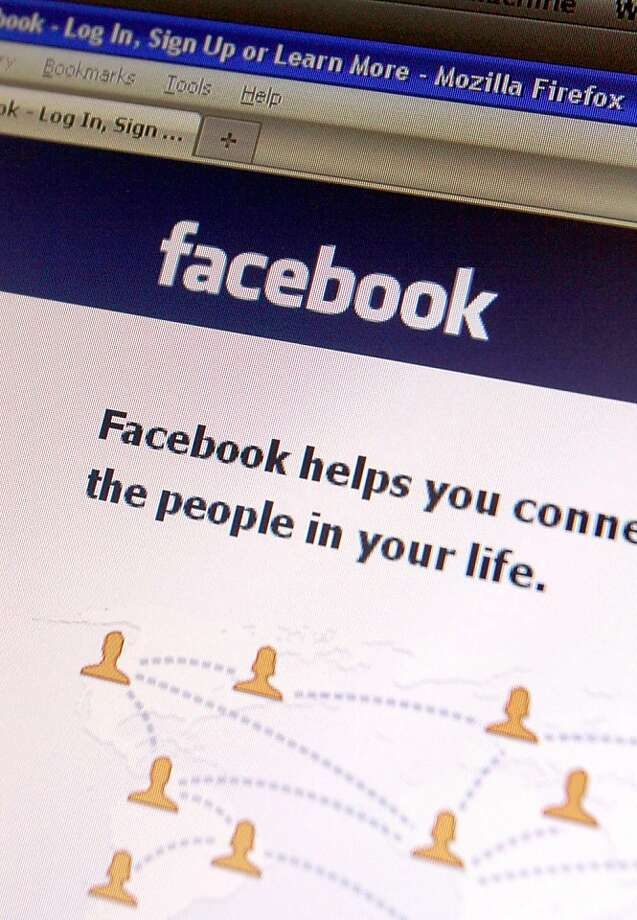 FILE - In this Feb. 11, 2011 photo, a Facebook page is seen on a computer in Montpelier, Vt. Following on the popularity of sites like Groupon, Facebook is launching its own daily deals program Tuesday, April 26, 2011 in five U.S. cities. The social network hopes to exploit the peer-to-peer aspect of group buying when it begins testing offers in San Diego, San Francisco, Austin, Atlanta and Dallas. Photo: Toby Talbot, AP