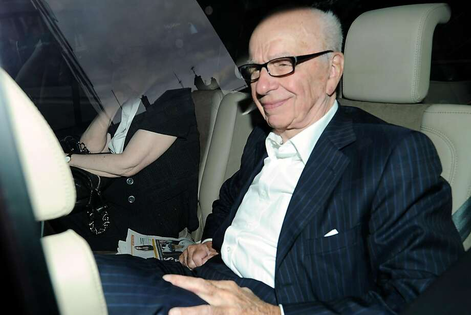 News Corp chief Rupert Murdoch arrives at his home in Westminster on July 11, 2011 in London. Britain's phone hacking scandal spiralled today amid reports that former premier Gordon Brown and the royals were targeted, as the government dealt a blow to Rupert Murdoch's bid for pay-TV giant BSkyB.  In a story taking new twists and turns by the hour and shaking the entire establishment, Brown was reportedly hacked by The Sunday Times and The Sun, both stablemates of Murdoch's doomed News of the World tabloid. Photo: Andrew Cowie, AFP/Getty Images