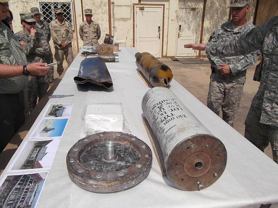 U.S. military members show Monday, July 11, 2011, in Baghdad, components for what U.S. military officers say were Iranian-made weapons used by Iraqi insurgents to target U.S. troops in recent weeks. Defense Secretary Leon Panetta expressed exasperation with Iraqi indecision on whether it wants U.S. troops to stay next year. He threatened stronger U.S. action to stop Iranian-supplied weapons from killing Americans as they prepare to depart. Photo: Robert Burns, AP
