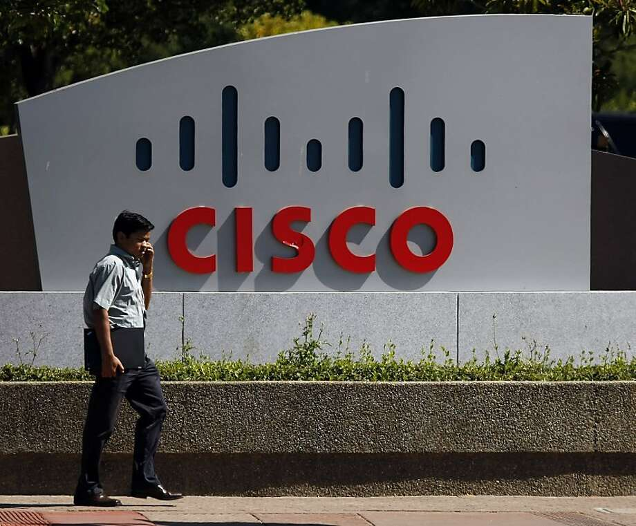 In this Aug. 9, 2010 photo, a pedestrian walks by a Cisco sign outside of the office headquarters  in San Jose, Calif. Cisco Systems Inc. releases financial results Wednesday, Aug. 11, after the market close. Photo: Marcio Jose Sanchez, AP