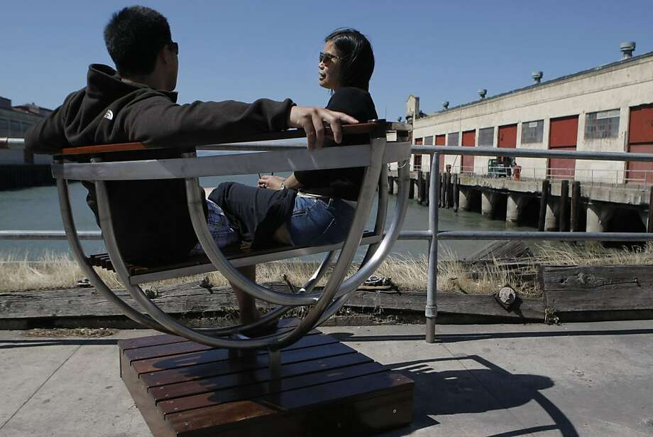 """Aubrey and Chad Narvasa cozy up in """"Bow Seat"""" by artist Oliver Dicicco for the SEAT art exhibit at the Fort Mason Center in San Francisco Calif.,  on July 2, 2011. Photo: Audrey Whitmeyer-Weathers, The Chronicle"""