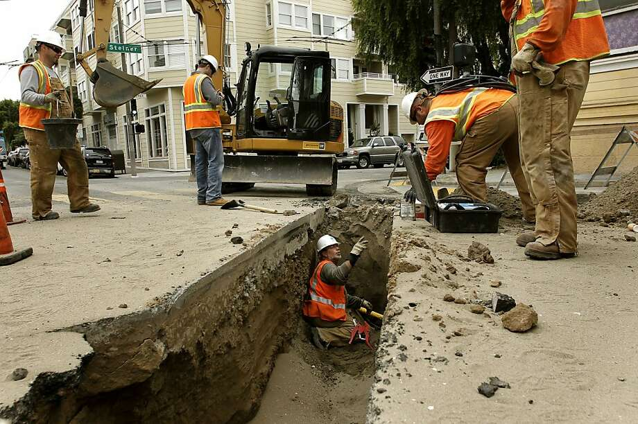 PG&E employee Gregg Eichhorn works in a ditch to repair the gas line in lower Pacific Heights neighborhood of San Francisco, Ca. on Wednesday April 20, 2011, which shut down several blocks surrounding the leak for two hours. The gas line break  was caused by a contractor digging at the site and a back hoe struck the gas main. Photo: Michael Macor, The Chronicle