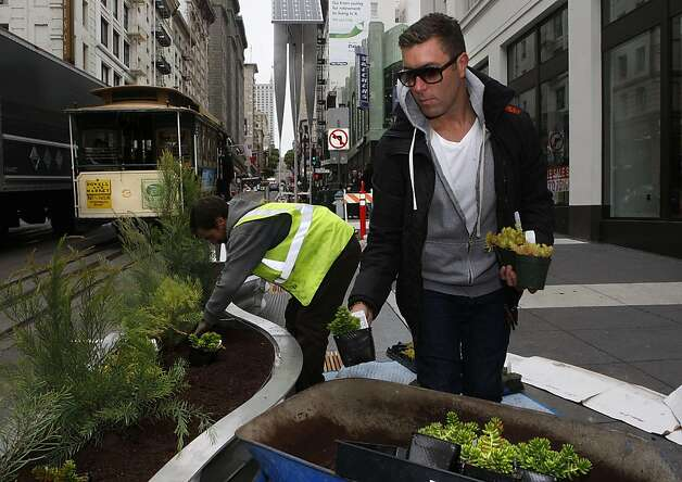 A  two-block stretch of parklets on Powell Street between Eddy and Geary streets in San Francisco, Calif., on Tuesday, July 12, 2011, which will be ready for public use tomorrow as planters are being filled by landscape architect Daniel Nolan. Photo: Liz Hafalia, The Chronicle