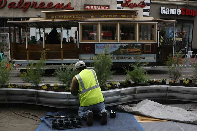 A two-block stretch of parklets on Powell Street between Eddy and Geary streets in San Francisco, Calif., on Tuesday, July 12, 2011, which will be ready for public use tomorrow as planters are being filled. Photo: Liz Hafalia, The Chronicle