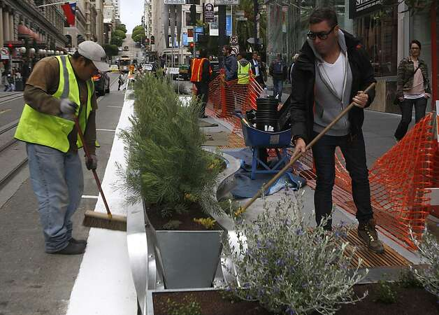 A two-block stretch of parklets on Powell Street between Eddy and Geary streets in San Francisco, Calif., on Tuesday, July 12, 2011, which will be ready for public use tomorrow as planters are being filled.  At right is landscape architect Daniel Nolan. Photo: Liz Hafalia, The Chronicle