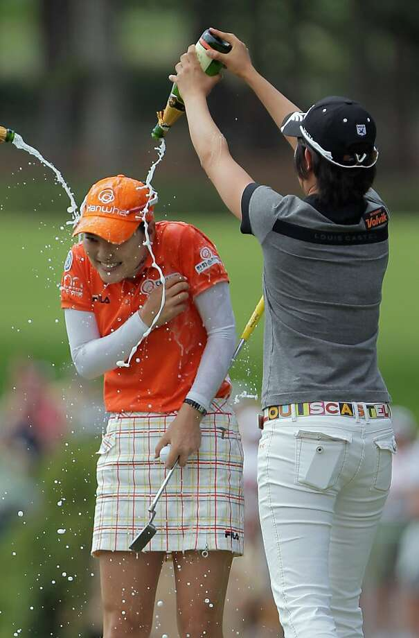 COLORADO SPRINGS, CO - JULY 11:  So Yeon Ryu of Korea is doused by champagne by Jinyoung Pak (R) of Korea after Ryu won the U.S. Women's Open in a playoff against Kee Kyung Seo of Korea at The Broadmoor on July 11, 2011 in Colorado Springs, Colorado. Ryu's birdie on the 18th hole forced a playoff with . Photo: Doug Pensinger, Getty Images