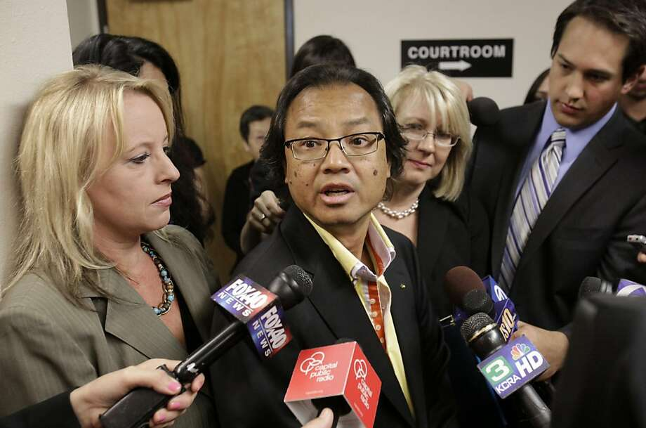 Fred Santos and his wife, Kathy, second from right, talk with reporters Monday, July 11, 2011, after the first hearing in their lawsuit against the state of California and former Gov. Arnold Schwarzenegger for reducing the manslaughter sentence for one ofthe men convicted in the death of their son, in Sacramento, Calif. The Santos' claim the state and Schwarzenegger violated Marsy's Law because he failed to notify them before reducing the 16-year manslaughter sentence of Esteban Nunez, the son of formerAssembly Speaker Fabian Nunez, D-Los Angeles,  who pleaded guilty in the 2008 slaying of college student Luis Santos. Photo: Rich Pedroncelli, AP