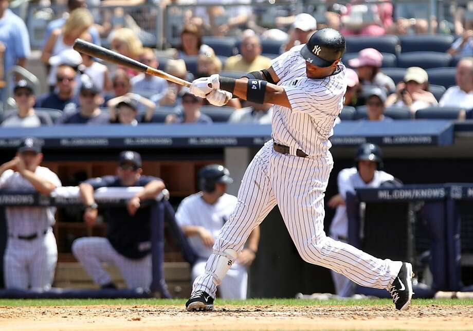 NEW YORK, NY - JULY 10: Robinson Cano #24 of the New York Yankees singles in the seventh inning against the Tampa Bay Rays at Yankee Stadium on July 10, 2011 in the Bronx borough of New York City. Photo: Nick Laham, Getty Images