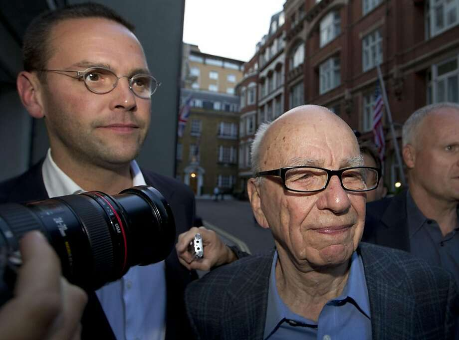 Chairman of News Corporation Rupert Murdoch, right, and his son James Murdoch, chief executive of News Corporation Europe and Asia arrive at his residence in central London, Sunday, July 10, 2011. News of the World cease publication with Sunday issue thelast. News of the World is accused of hacking into the mobile phones of crime victims, celebrities and politicians. Photo: Sang Tan, AP