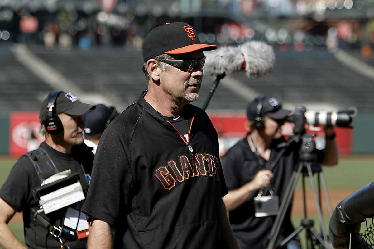 """Manager Bruce Bochy close by as the crew shoots batting practice before the game, at AT&T Park in San Francisco, Ca., on Friday June 24, 2011. The production crew of the Showtime feature, """"The Franchise"""" follows the behind-the-scenes of the many people who play for and run the San Francisco Giants."""