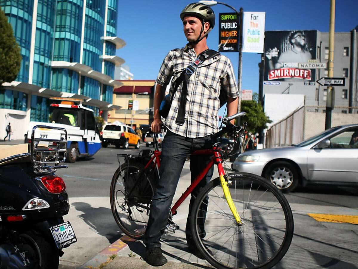 Ed Campaniello stands with his bike on 5th Street in San Francisco on July 7, 2011. Campaniello bikes from the Mission to his job as a consultant at the Hub despite a Canadian study that found that cyclists experience heart irregularities after riding in heavy traffic.