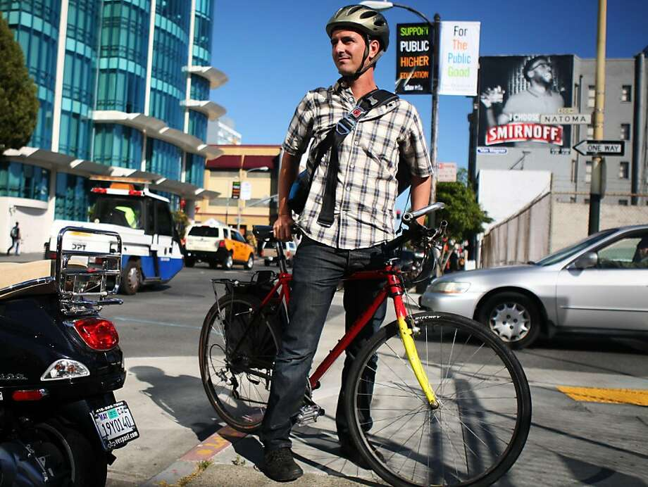 Ed Campaniello stands with his bike on 5th Street in San Francisco on July 7, 2011. Campaniello bikes from the Mission to his job as a consultant at the Hub despite a Canadian study that found that cyclists experience heart irregularities after riding in heavy traffic. Photo: Maddie McGarvey, The Chronicle