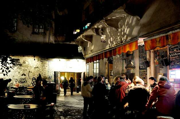 "The eclectic ""ruin-pub"" scene in Budapest usually spills out of the bars and into courtyards. Photo: Cameron Hewitt"