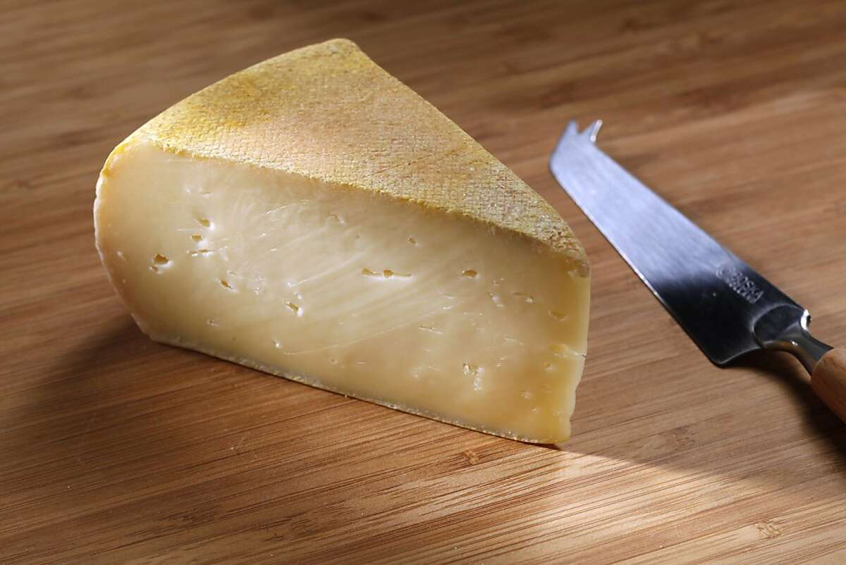 The highly aromatic Secret du Couvent has a semi-firm, pale gold interior with many small eyes.