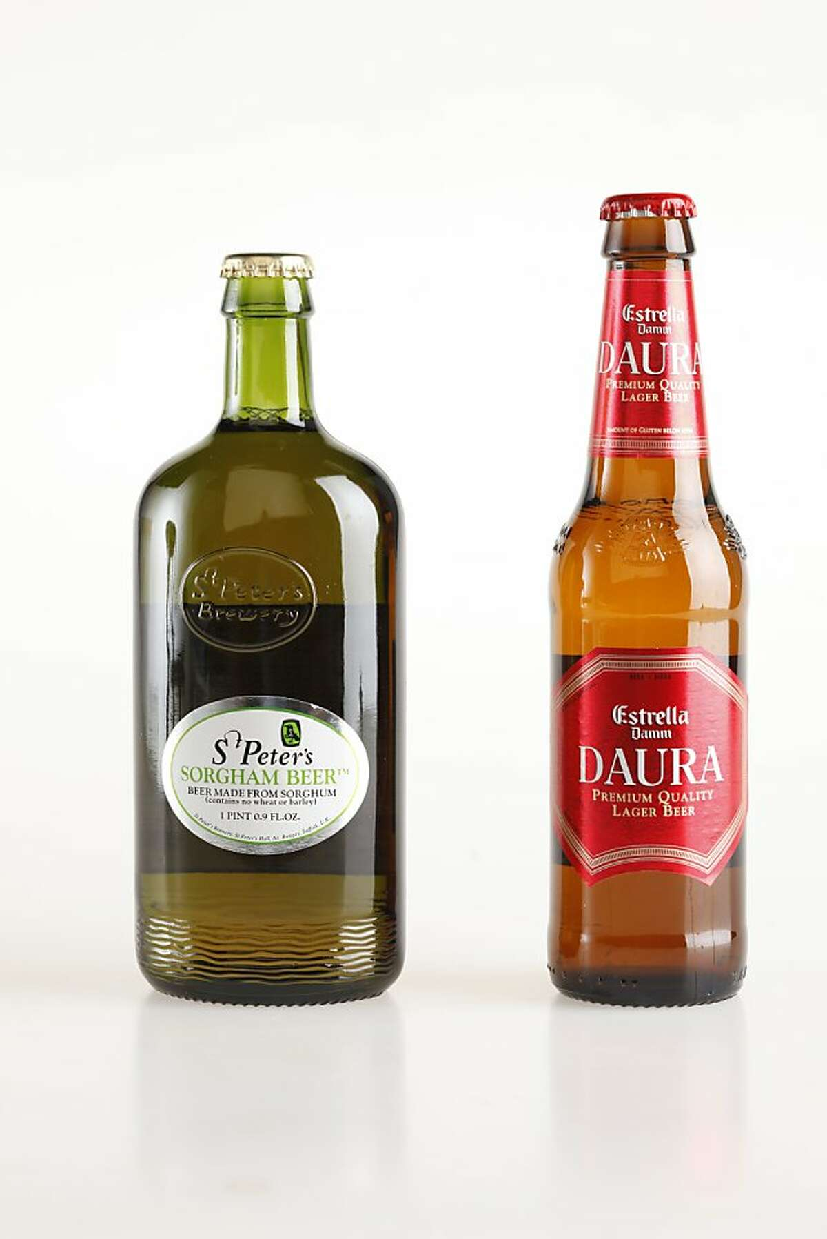 St. Peter's Sorgham Beer, left, and Estrella Damm Daura, Barcelona, Spain.