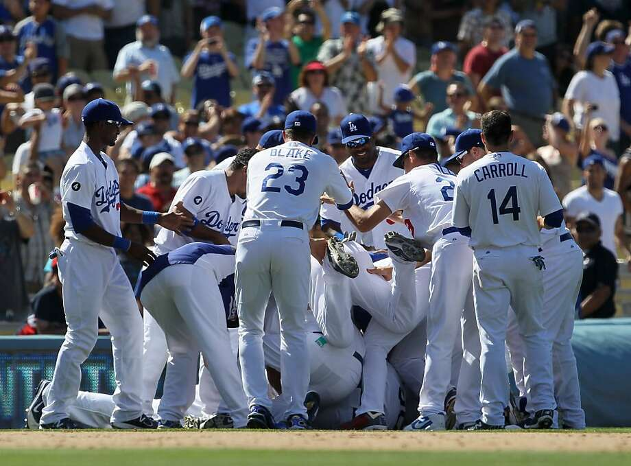 LOS ANGELES, CA - JULY 9:  Los Angeles Dodgers players  mob Dioner Navarro #30 after his walk off RBI single with two outs in the ninth inning beat the San Diego Padres on July 9, 2011 at Dodger Stadium in Los Angeles, California. The Dodgers won 1-0. Photo: Stephen Dunn, Getty Images
