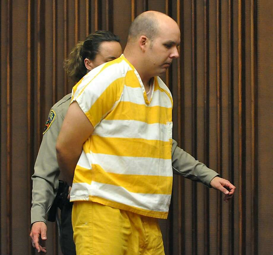 James Raphael Mitchell is lead out of court after his appears in Marin County Superior Court on Friday, July 24, 2009 in San Rafael, Calif. where he pleaded not guilty in the slaying of his girlfriend, Danielle Keller. Photo: Robert Tong, Marin Independent Journal / Pool
