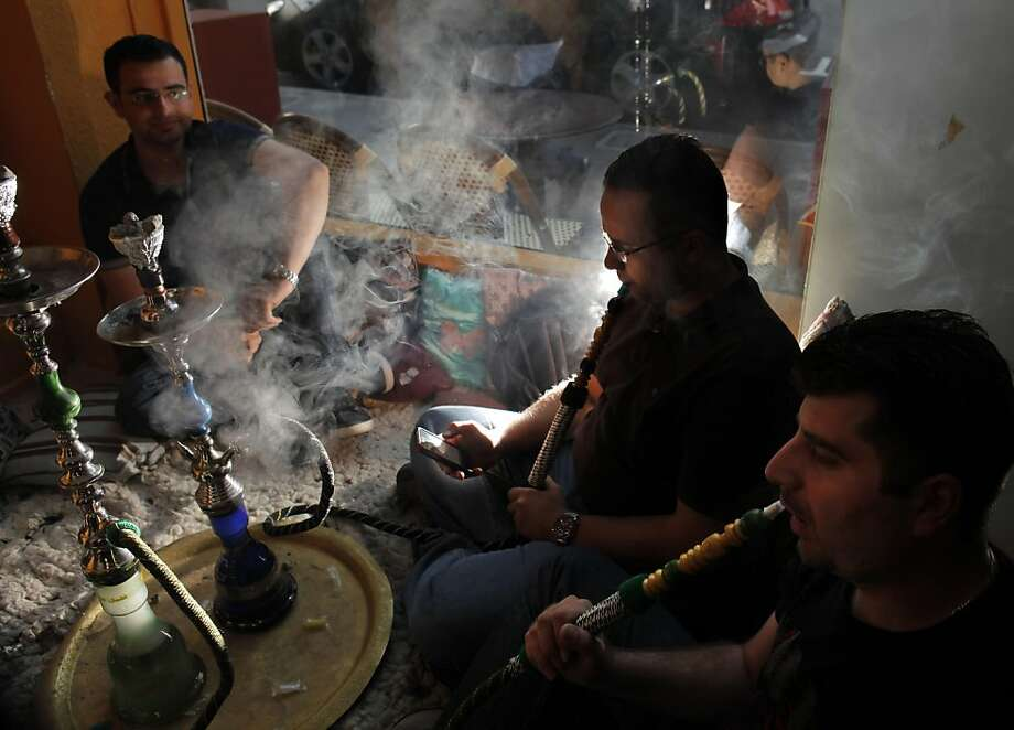 Customers enjoy some hookah at Cairo Nights in San Francisco, Calif., on Wednesday, July 6, 2011.  Khaled Hegazy started Cairo Nights when he emigrated from Egypt in 2009, but now San Francisco's hookah bars might close under state and city laws that ban smoking in all indoor and outdoor dining areas. The owners of several hookah bars have spent years resisting, continuing with business as usual. Hegazy enjoys a steady stream of customers and promises to fight the city in court if they try to shut down his livelihood. Photo: Carlos Avila Gonzalez, The Chronicle