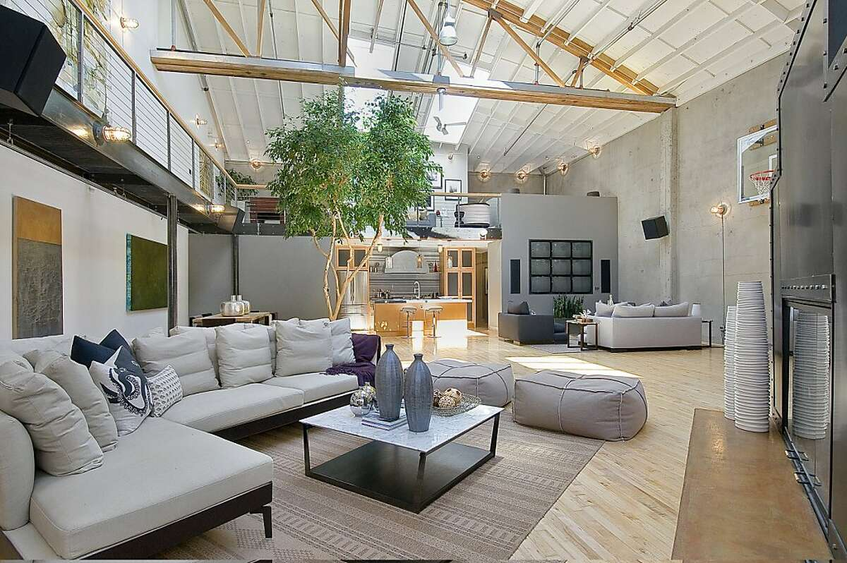This is a living room with a vaulted ceiling.