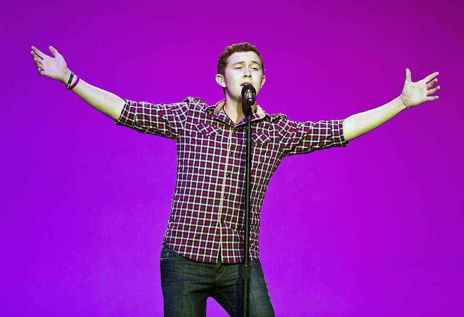 American Idol winner Scotty McCreery performs during the Wal-Mart Stores Inc. annual shareholder meeting in Fayetteville, Arkansas, U.S., on Friday, June 3, 2011. Wal-Mart Stores Inc. renewed plans to buy back as much as $15 billion of its shares, potentially bolstering the Walton family's control of the world's largest retailer. Photographer: Beth Hall/Bloomberg *** Local Caption *** Scotty McCreery Photo: Beth Hall, Bloomberg