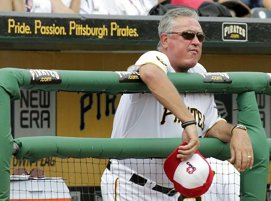 Pittsburgh Pirates manager Clint Hurdle stands in the dugout during the Pirates' 5-3 win over the Houston Astros in a baseball game in Pittsburgh on Monday, July 4, 2011. Photo: Gene J. Puskar, AP
