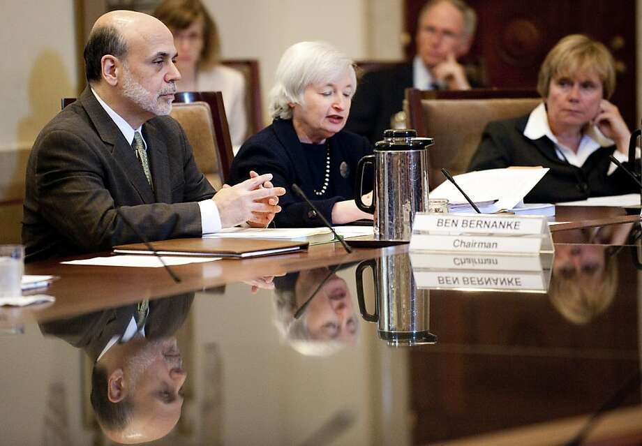 Chairman of the Federal Reserve Ben Bernanke (L) delivers remarks during a meeting at the Federal Reserve in Washington, DC, June 29, 2011. Photo: Jim Watson, AFP/Getty Images