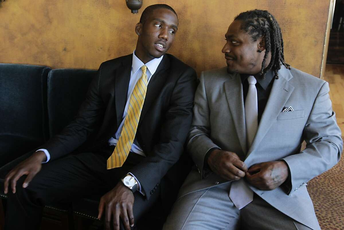 """Tampa Bay Buccaneers quarterback Josh Johnson, left, and his cousin, Seattle Seahawks running back Marshawn Lynch, wait to announce their new """"Fam 1st Family Foundation"""" in San Francisco, Calif. on Thursday, July 7, 2011, which will serve underprivileged Bay Area youth."""